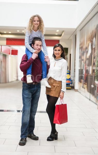 Portrait of happy family in shopping mall Stock photo © wavebreak_media
