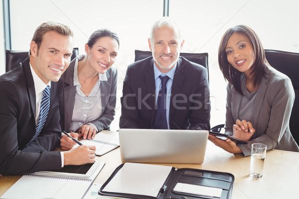 Businesspeople smiling in conference room Stock photo © wavebreak_media