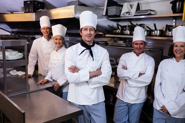 Heureux chefs équipe permanent ensemble commerciaux Photo stock © wavebreak_media