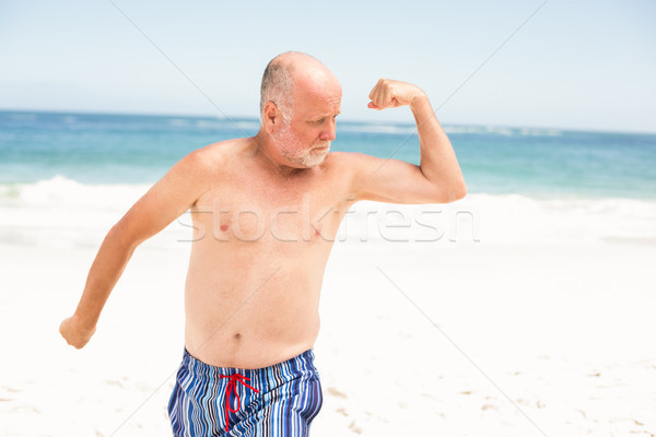 Supérieurs homme posant muscles eau Photo stock © wavebreak_media