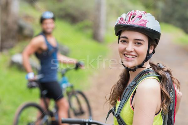 Portrait of confident female biker with man Stock photo © wavebreak_media