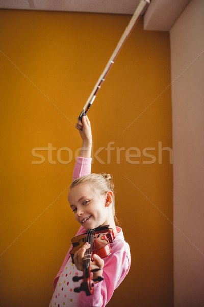 девушки играет скрипки желтый счастливым ребенка Сток-фото © wavebreak_media