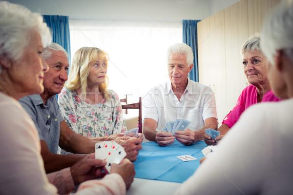 Grupo cartas de jogar aposentadoria casa mulher Foto stock © wavebreak_media