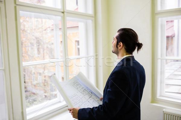 Blauwdruk naar venster creatieve kantoor Stockfoto © wavebreak_media