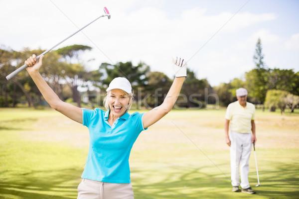 Portré derűs golfozó nő karok a magasban áll Stock fotó © wavebreak_media