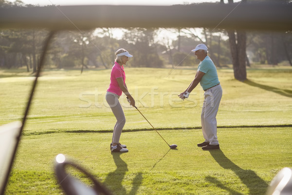 зрелый человек преподавания женщину играть гольф Постоянный Сток-фото © wavebreak_media
