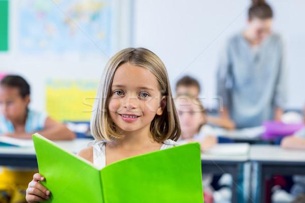 Cute girl reading book Stock photo © wavebreak_media