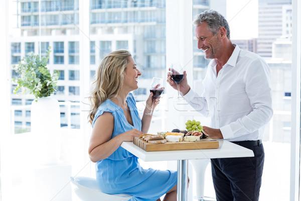 Smiling mature couple holding red wine Stock photo © wavebreak_media