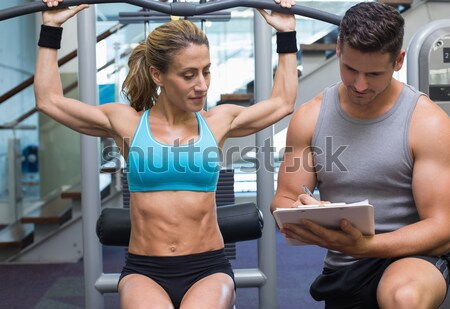 Portrait of cheerful female friends with arms crossed in gym Stock photo © wavebreak_media