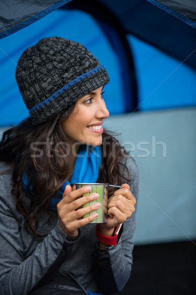 Smiling hiker having a cup of coffee in tent Stock photo © wavebreak_media