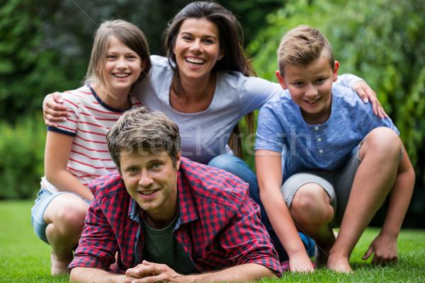 Happy family smiling in park Stock photo © wavebreak_media