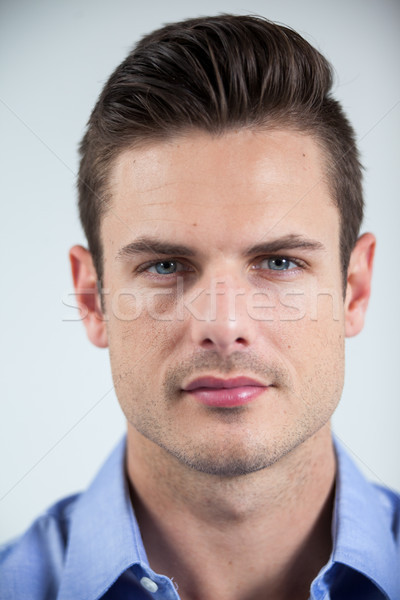 Homme lentilles de contact portrait blanche amusement Photo stock © wavebreak_media