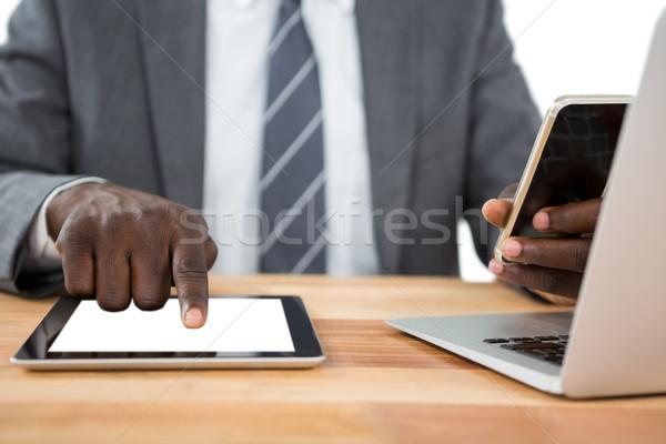 Középső rész üzletember digitális tabletta egyéb multimédia Stock fotó © wavebreak_media