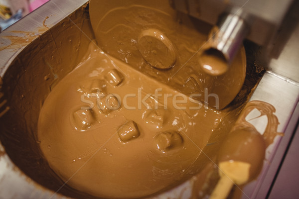 Close-up of marshmallow dipped in chocolate blending machine Stock photo © wavebreak_media