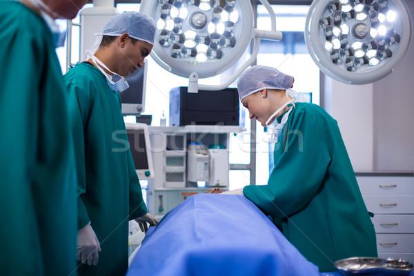 Surgeons performing operation in operation theater Stock photo © wavebreak_media