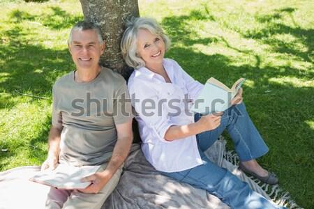 Senior couple looking at blueprint in the garden Stock photo © wavebreak_media