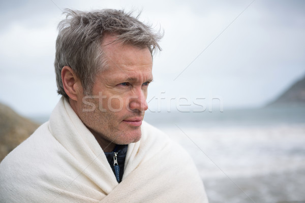 Thoughtful man wrapped in shawl Stock photo © wavebreak_media