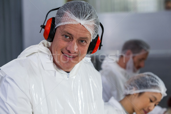 Smiling butcher in protective headphones Stock photo © wavebreak_media