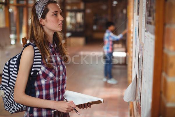 школьница чтение коридор школы девушки Сток-фото © wavebreak_media
