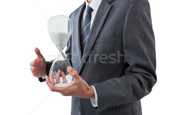 Mid section of businessman holding hourglass Stock photo © wavebreak_media