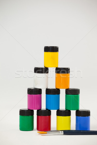 Pyramid of watercolor paints and paint brushes Stock photo © wavebreak_media