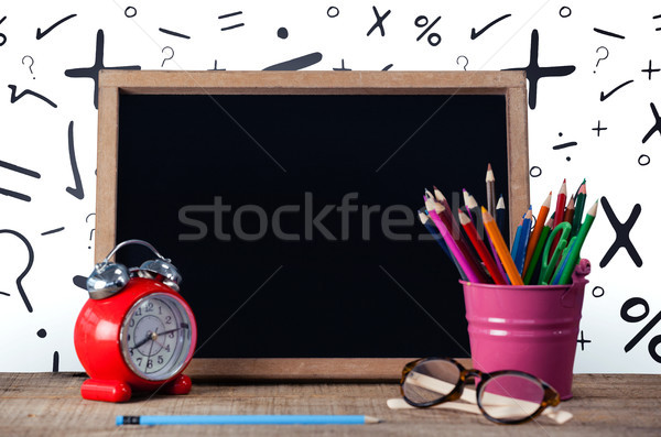 Slate with desk organizer and alarm clock by eyeglasses against white background Stock photo © wavebreak_media