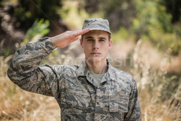 Portrait of military soldier giving salute Stock photo © wavebreak_media