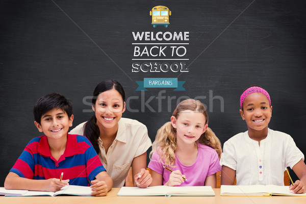 Stock photo: Composite image of pretty teacher helping pupils in library