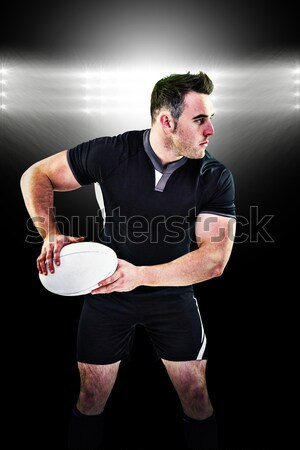 Composite image of rugby player about to throw a rugby ball Stock photo © wavebreak_media
