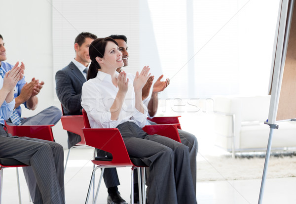 Multi-ethnic business people clapping at the end of a conference Stock photo © wavebreak_media