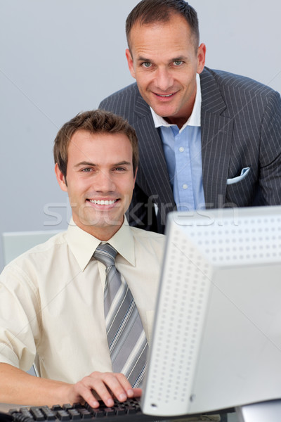 Assertive business partners working together at a computer  Stock photo © wavebreak_media