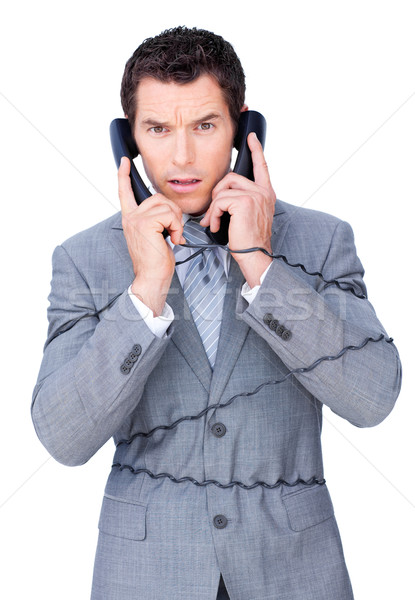 Angry businessman tangle up in phone wires  Stock photo © wavebreak_media
