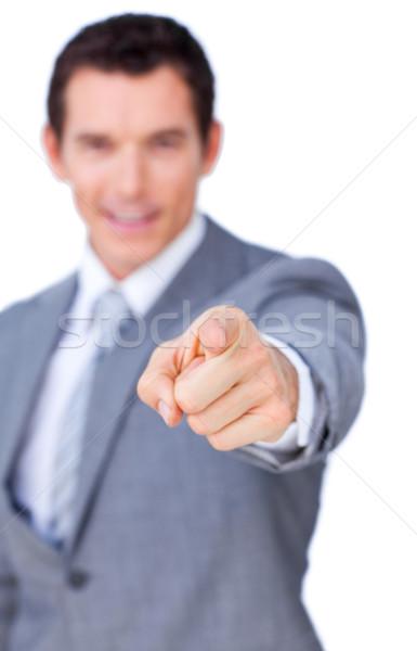 Pozytywny biznesmen wskazując kamery odizolowany biały Zdjęcia stock © wavebreak_media