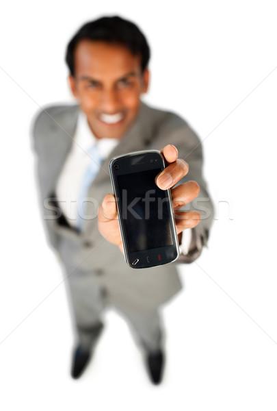Enthusiastic businessman showing a mobile phone  Stock photo © wavebreak_media
