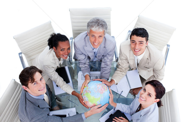 High angle of positive business people holding a terrestrial glo Stock photo © wavebreak_media