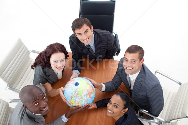 High view of happy business people holding a globe. Global busin Stock photo © wavebreak_media