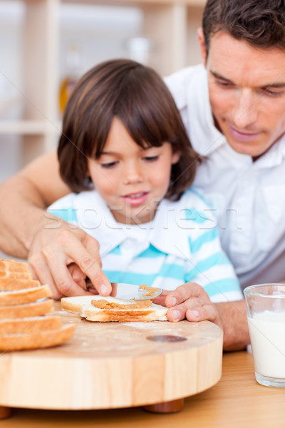 Zärtlich Vater-Sohn Marmelade Brot Familie Stock foto © wavebreak_media