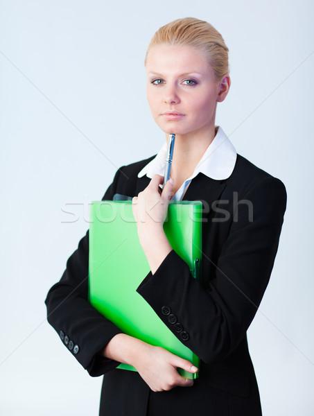 Woman standing holding a folder Stock photo © wavebreak_media