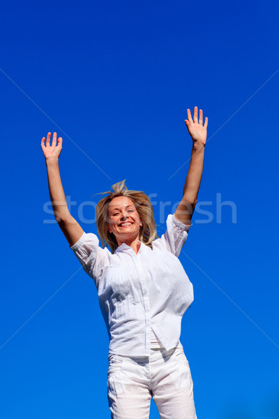 Carefree woman enjoying life against blue sky Stock photo © wavebreak_media