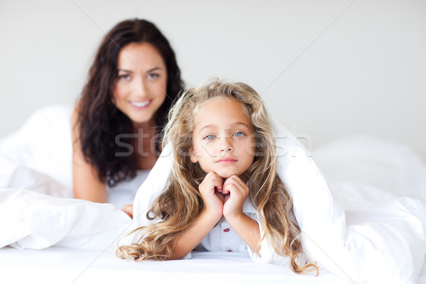 Young Mother and daugther having fun on bed Stock photo © wavebreak_media