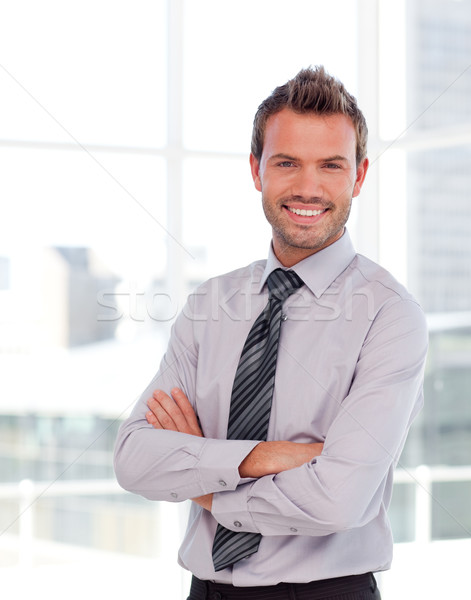 Handsome businessman with folded arms Stock photo © wavebreak_media