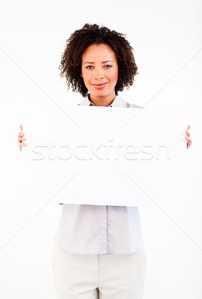 Friendly businesswoman holding big businesscard  Stock photo © wavebreak_media