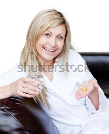 Gyönyörű nő tart gyógyszer fehér víz kéz Stock fotó © wavebreak_media