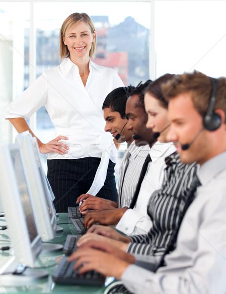 улыбаясь женщины менеджера ведущий представитель команда Сток-фото © wavebreak_media