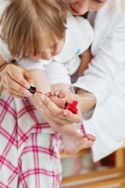 Helping mother making her daughter's nails in bathroom Stock photo © wavebreak_media