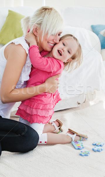 Derűs kislány ölel anya otthon lány Stock fotó © wavebreak_media