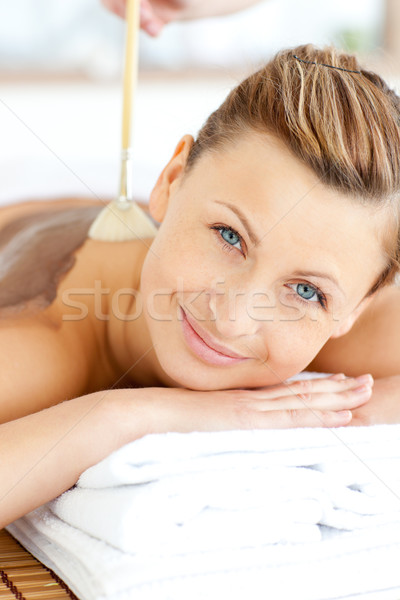 Portrait of a beautiful woman receiving a beauty treatment with mud in a health spa Stock photo © wavebreak_media