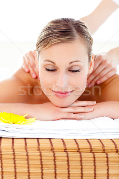 Portrait of a bright woman lying on a massage table in a health spa Stock photo © wavebreak_media