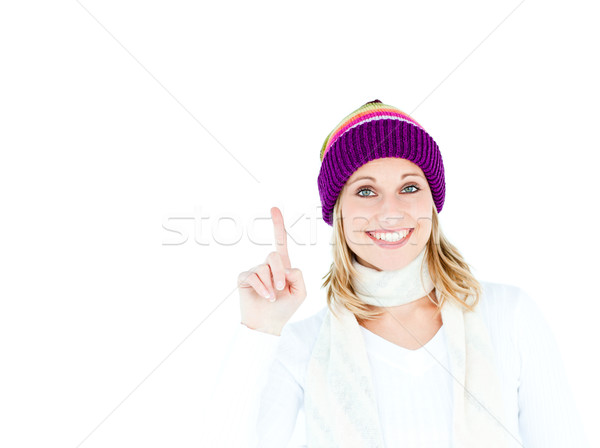 Joyful woman with a colorful hat pointing upwards against a white background Stock photo © wavebreak_media