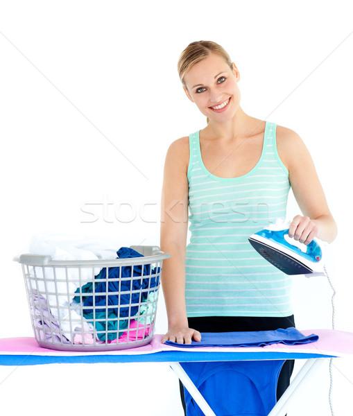 Cute woman ironing against a white background Stock photo © wavebreak_media